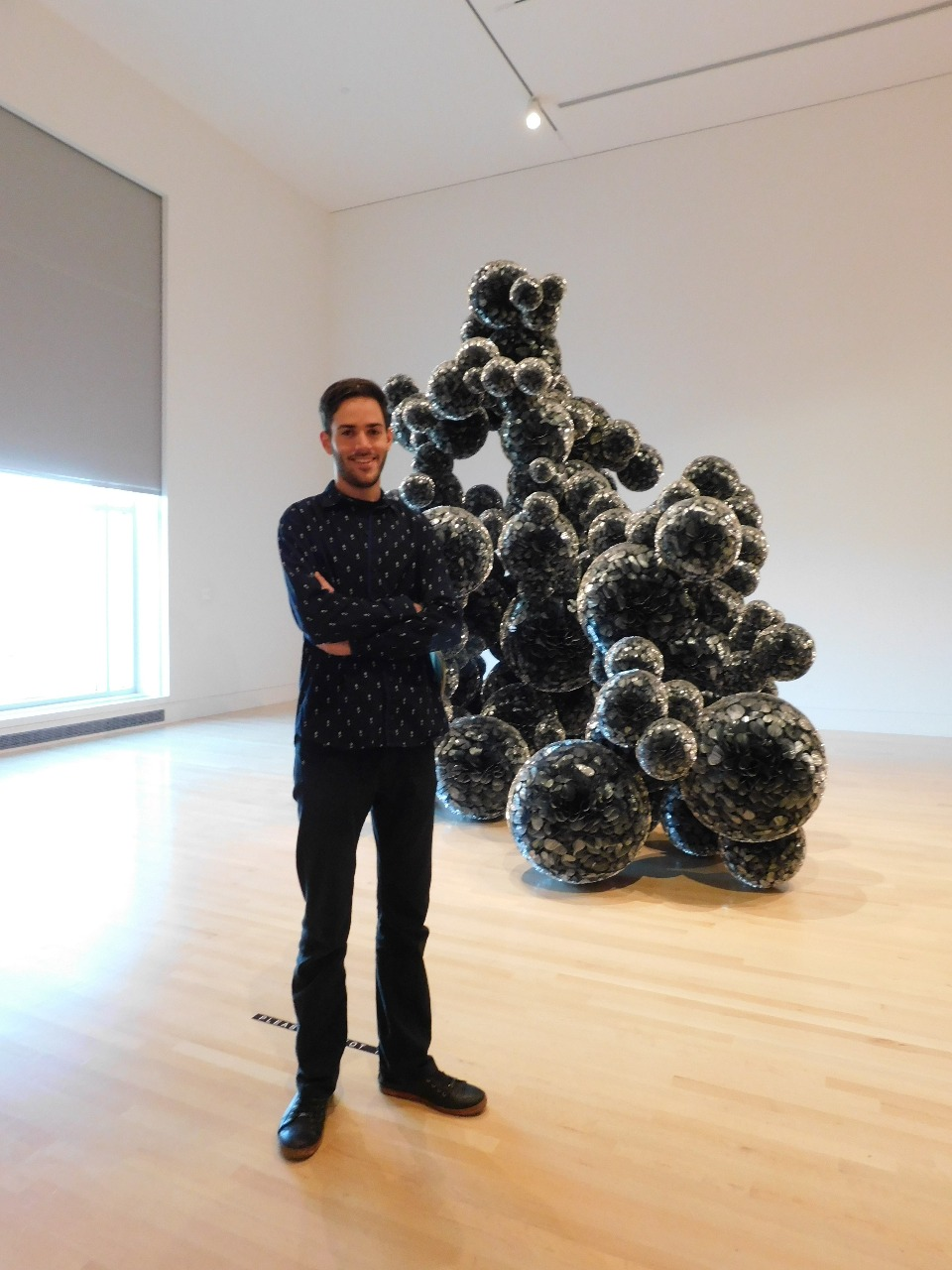 "Student Tomás Lopez Cajaraville at the Indianapolis Museum of Art with the sculpture ""Untitled (Mylar)"" by Tara Donovan, which he describes as ""one of the most fascinating contemporary sculptures I have ever seen."""
