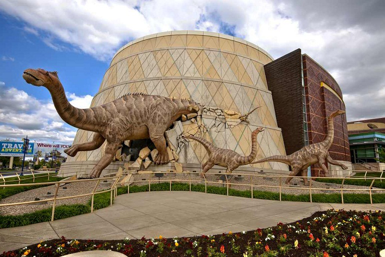 Indy Children's museum with dinosaurs in front of the building