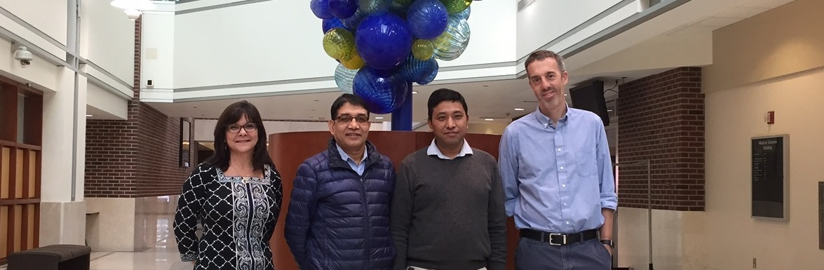 Dr. Krishna Bahadur Tamang poses in University Hospital at IUPUI with his hosts, Dr. Simon Warren and Dr. Debra Woods